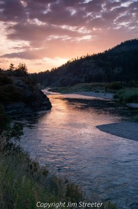 The dying rays of a winter sunset shimmer on the Blackfoot river near Missoula, Montana.