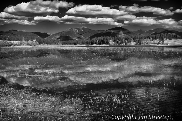 Clouds reflect in the waters of Upsata lake in the Blackfoot valley of western Montana.