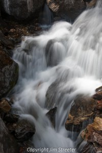 Water cascades over rock in the Payette river outside of McCall, Idaho.