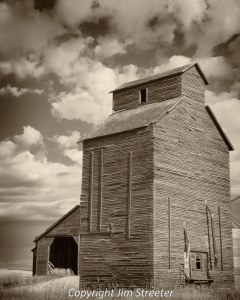 "An old-fashioned wooden grain elevator outside of Walthom, Montana. This area is known as the ""golden triangle"" for the vast acreage devoted to grain production."