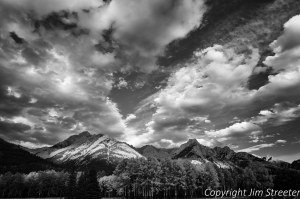 Clouds scudding across the sky after an early fall storm along the Icefields Parkway in Alberta, Canada. The Icefields Parkway runs 230 kilometres between Lake Louise and Jasper, Alberta, crossing through Banff National Park and Jasper National Park.