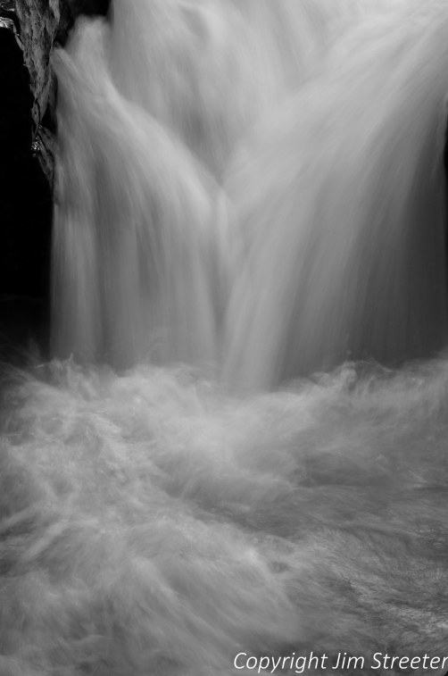 Panther Falls in surreal slow motion as it tumbles through the canyon carved by Nigel Creek long the Icefields Parkway in Banff National Park.