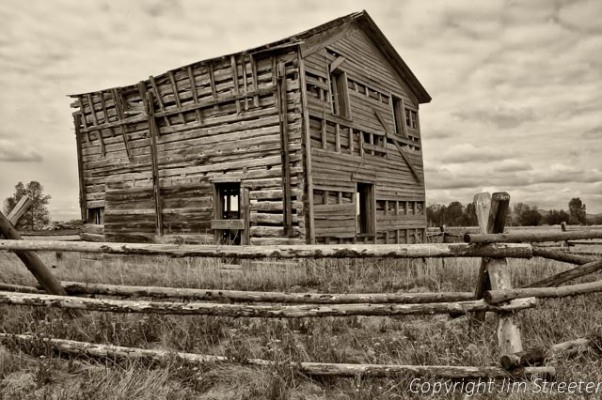 The Gallatin City Hotel, built in 1868, was later turned into a barn before being abandoned. It is built out of hewn logs and sits outside of Bozeman, Montana.