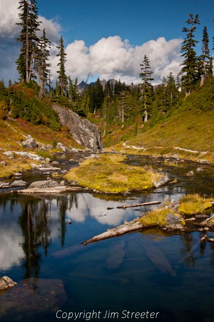 One of the lakes along the Chain Lakes trail in North Cascades National Park reflects the fall scenery.
