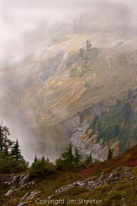 Clouds partially obscure the mountains in North Cascades National Park in western Washington.