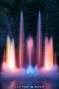 The evening light show plays on the waters of Ross Fountain in the Butchart Gardens in British Columbia, Canada.