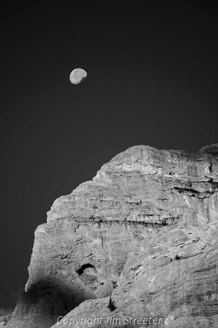 A fall moon hangs over Mt. Kidd in Kananaskis Provincial Park in Alberta, Canada.