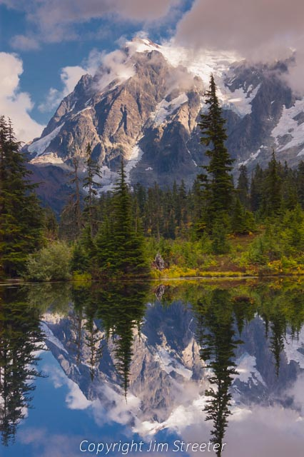 Mount Shuksan is reflected in a roadside pond in North Cascades National Park in western Washington.