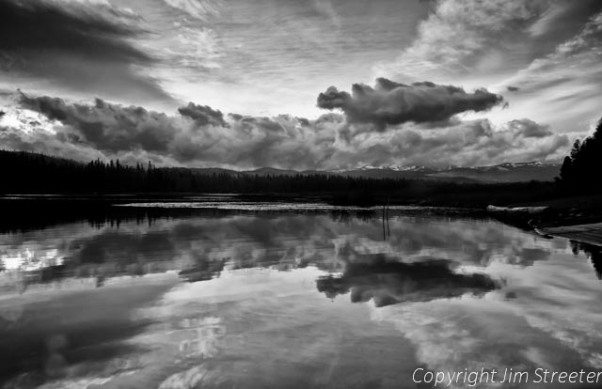 Clouds seem to explode from the dying rays of the sun over Seeley Lake in western Montana.