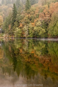 Fall foliage reflects in the still surface of Silver Lake in western Washington.