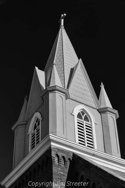 The steeple of the Butte Unity Truth Center stretches towards the sky in Butte, Montana.