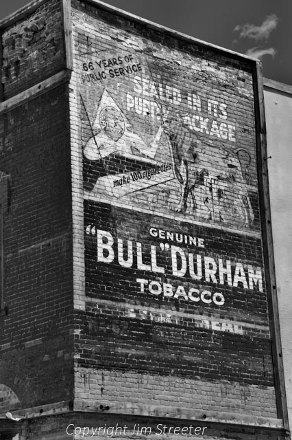 An old painted advertisement for Bull Durham tobacco decorates the side of a building in Butte, Montana.