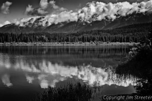 Reflection of clouds and the Swan Range in Rainy Lake in the Seeley-Swan valley of western Montana.