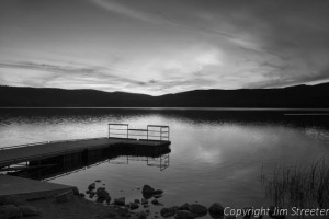 A dock is silhouetted in the last light of a fall evening on Lake Mary Ronan, just west of Flathead Lake in western Montana.