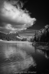 Clouds linger over Elbow Lake after a fall storm. The lake in located in the Kananaskis Valley of Alberta in western Canada.