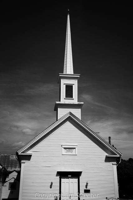 The United Methodist Church in Sutter Creek, California, was built in 1862 during California's gold rush. The church features stained glass windos, a traditional white steeple and a raised pulpit for the preacher.