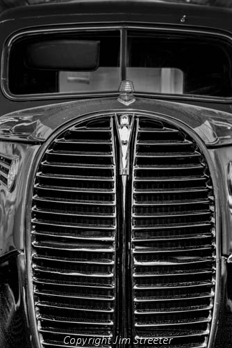 Closeup of the grill on a 1938 Ford flatbed truck once used at the Farragut Naval Training Station. The truck is on display at the Museum at the Brig, now part of Farragut State Park in northern Idaho. The park was originally built as Farragut Naval Training Station to train sailors the the US Navy during World War II.