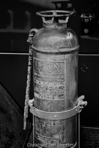Fire extinguisher sits on the back of a 1942 Pirsch fire engine on display in the courtyard of the Museum at the Brig at Farragut State Park in northern Idaho. The park was originally built as Farragut Naval Training Station to train sailors the the US Navy during World War II.