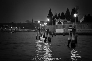 Lights reflect on the Venice lagoon at night. These lights are used by watercraft to guide their progress between the islands in the lagoon.