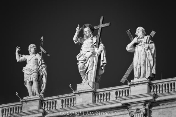 Statues of John the Baptist, Jesus Christ and Saint Andrew stand atop the colonnade overlooking St. Peter's Square at the Vatican in Rome, Italy. The statues were created by various sculptors between 1662 and 1703 and are part of a group of 140 statues that ring the square.