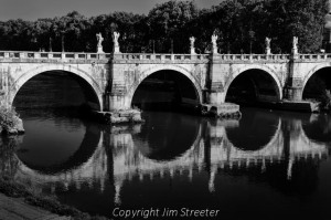 The Saint Angelo bridge carries pedestrians over the Tiber river in central Rome. The bridge was built in 134 A.D. during the reign of Emperor Hadrian.