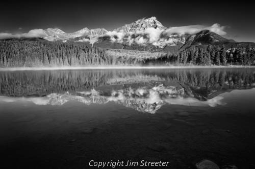 Pyramid Mountain reflects in Patricia Lake on a clear fall morning in Jasper National Park in Alberta, Canada.