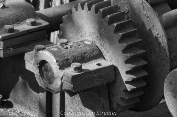 Gearing on an antique piece of coal mining equipment from the Bankhead mine in Alberta, Canada. The equipment sits on display as part of the an interpretive exhibit outside of Banff, Alberta.
