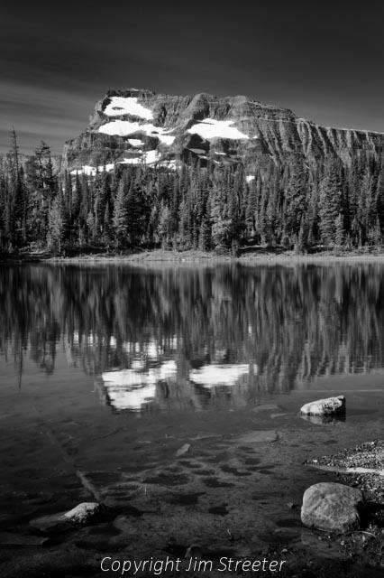 Cameron Lake reflects the peaks of the Akamina ridge in Waterton Lakes National Park, Alberta,