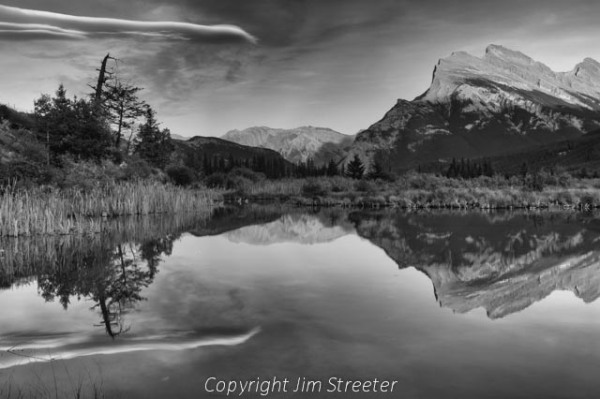 Mount Rundle is reflected in Vermilion Lakes. Mt. Rundle is located just outside of the town of Banff, Alberta in Banff National Park.
