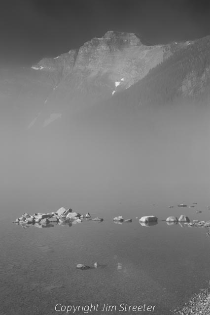 Fog obscures most of Cameron lake on a fall morning in Waterton Lakes National Park. Cameron lake sits under Akamina Ridge.