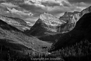 Clouds from a summer storm roll over Logan Pass at Glacier National Park in Montana. Glacier Park is the US portion of Waterton-Glacier International Peace Park which spans the US-Canada border. Logan Pass is reached via Going to the Sun Road which crosses the park.