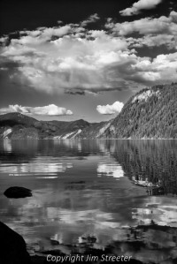 Reflected clouds shimmer in the still waters of Lake Pend Oreille in early summer. The lake is located on the Idaho panhandles and covers 148 square miles.