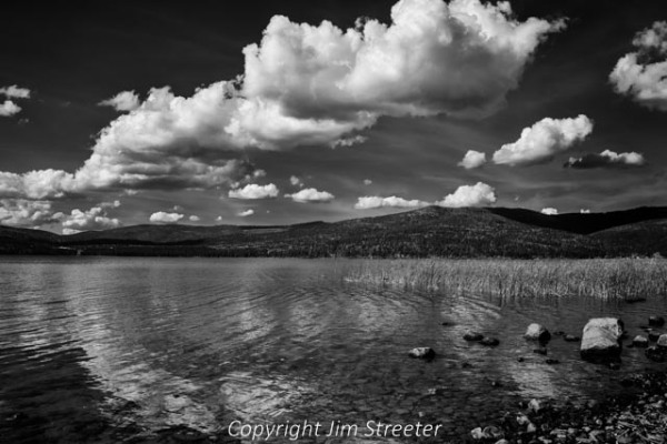 Afternoon clouds float across the sky on an autumn day at Lake Mary Ronan, just west of Flathead Lake in western Montana.