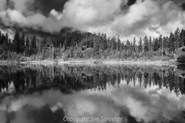 One of the lakes along the Chain Lakes trail in North Cascades National Park reflects the early autumn cloudscape.