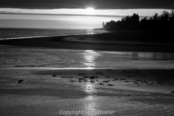 The last rays of the sun glint off the water along the coast of the Olympic peninsula in western Washington state.