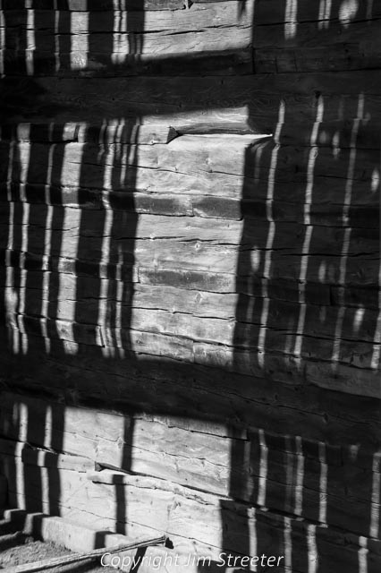 Shadows play on the side of an old cabin still standing on the Mt. Haggin Wildlife Management Area south of Anaconda, Montana.