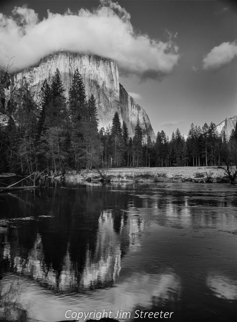 Yosemite Valley has many places to take photographs and enjoy a one of a kind place of nature. The Merced river runs through the valley and here El Capitan is reflected in the river.