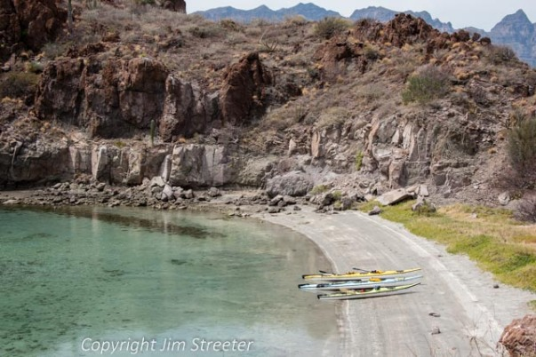 Three kayaks sit on the beach of Isla Danzante , one of five islands in Loreto Bay National Park. The bay is part of the Sea of Cortez in Baja, Mexico.