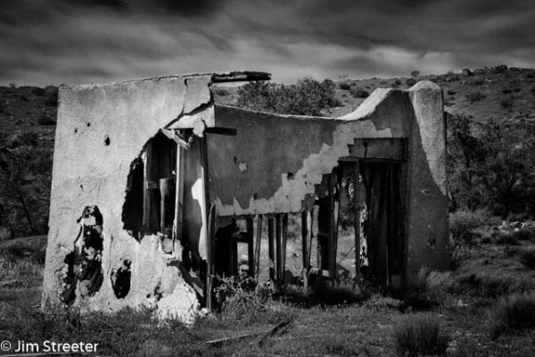 """The remains of a movie set for a Mexican village still stand in the Red Cliffs National Conservation Area near Hurricane, Utah. The set was part of a 1959 Gary Cooper film entitled """"They Came to Cordura"""". Weather and time are steadily wearing away the facade, revealing the bare inner structure of the building."""