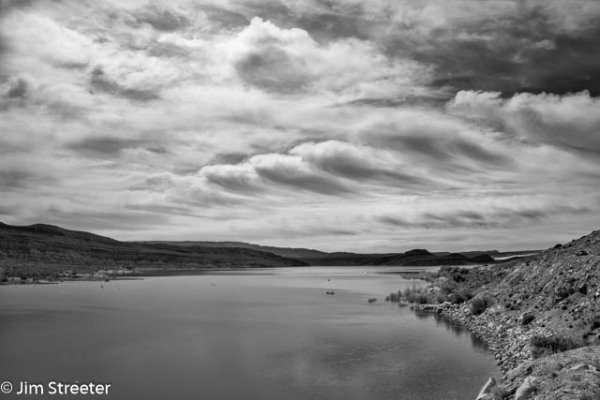 Clouds scud over the water at Quail Creek Reservoir on a spring afternoon. The reservoir is located in Quail Creek State Park in southwest Utah.
