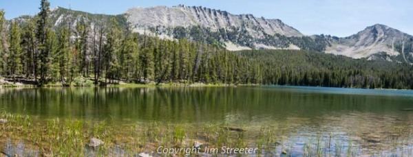 Sawtooth peak and Highboy mountain reflect in Sawtooth lake on a summer afternoon. The lake is located in the east Pioneer mountains west of Dillon in southwest Montana.