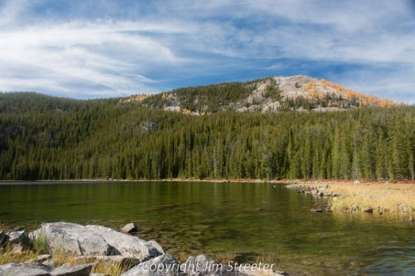 Mountains of the Anaconda-Pintler Wilderness tower over Carpp lake on a fall afternoon. This 159,,000-acre wilderness straddles the Continental Divide in western Montana.