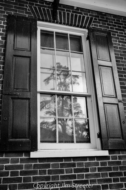 A tree reflects in the window of a building in the Lower Town section of Harpers Ferry National Historic Park in West Virginia. The town played a pivotal part in the American Civil War.
