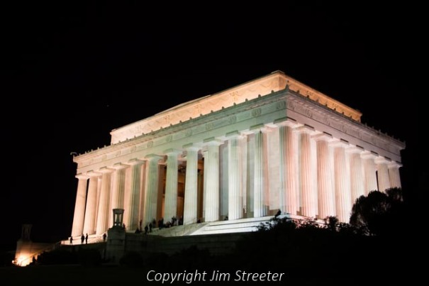 The Lincoln Memorial in Washington DC glows after dark. The memorial was built to honor America's 16th president, Abraham Lincoln. Inside sits the 19-foot tall statue of Lincoln sitting in contemplation and surround by his greatest addresses chiseled in stone.
