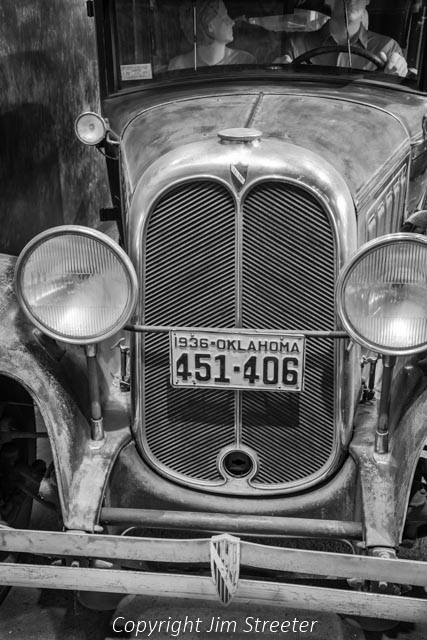 The radiator grill on this 1929 Oakland sedan sports an Oklahoma license plate as it sits on display in the Smithsonian American History Museum. The model was a moderately priced mass-produced luxury vehicle made by General Motors. It was last driven in 1950.