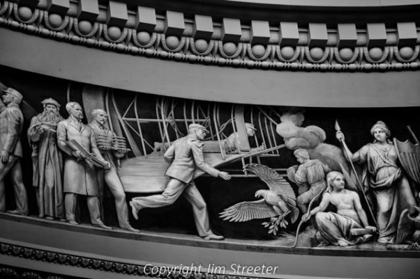 Wilbur and Orville Wright and the first airplane are depicted in the frescoed frieze that decorates the upper part of the Capitol Rotunda. The frieze traces American history from its discovery by Columbus to the birth of aviation.