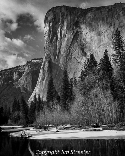 El Capitan, a 3000-foot granite monolith, is seen from the back of Yosemite Valley in early spring.