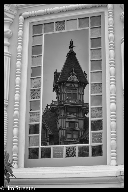 The Carson Mansion is reflected in a window of The Pink Lady – a Classic Victorian Mansion across the street from the Carson Mansion. Originally built by William Carson, the infamous lumber baron who erected the world famous Carson Mansion across the street. The Pink Lady was a wedding gift for his son Milton Carson.