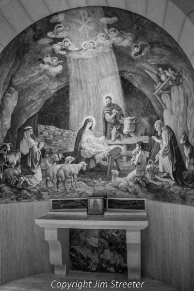 The painting depicts the birth of Jesus, and is one of several found in the Chapel of the Shepherds' Field in Beit Sahur southest of Bethlehem. Tradition holds that the angel appeared to the shepherds on this spot to announce the birth of Jesus.