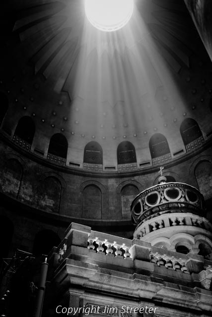 Sunlight streams into the Church of the Holy Sepulchre in Jerusalem, lighting up the Aedicule which contains the tomb of Christ.